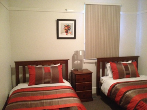 Middle bedroom has two king single beds, also built in wardrobe